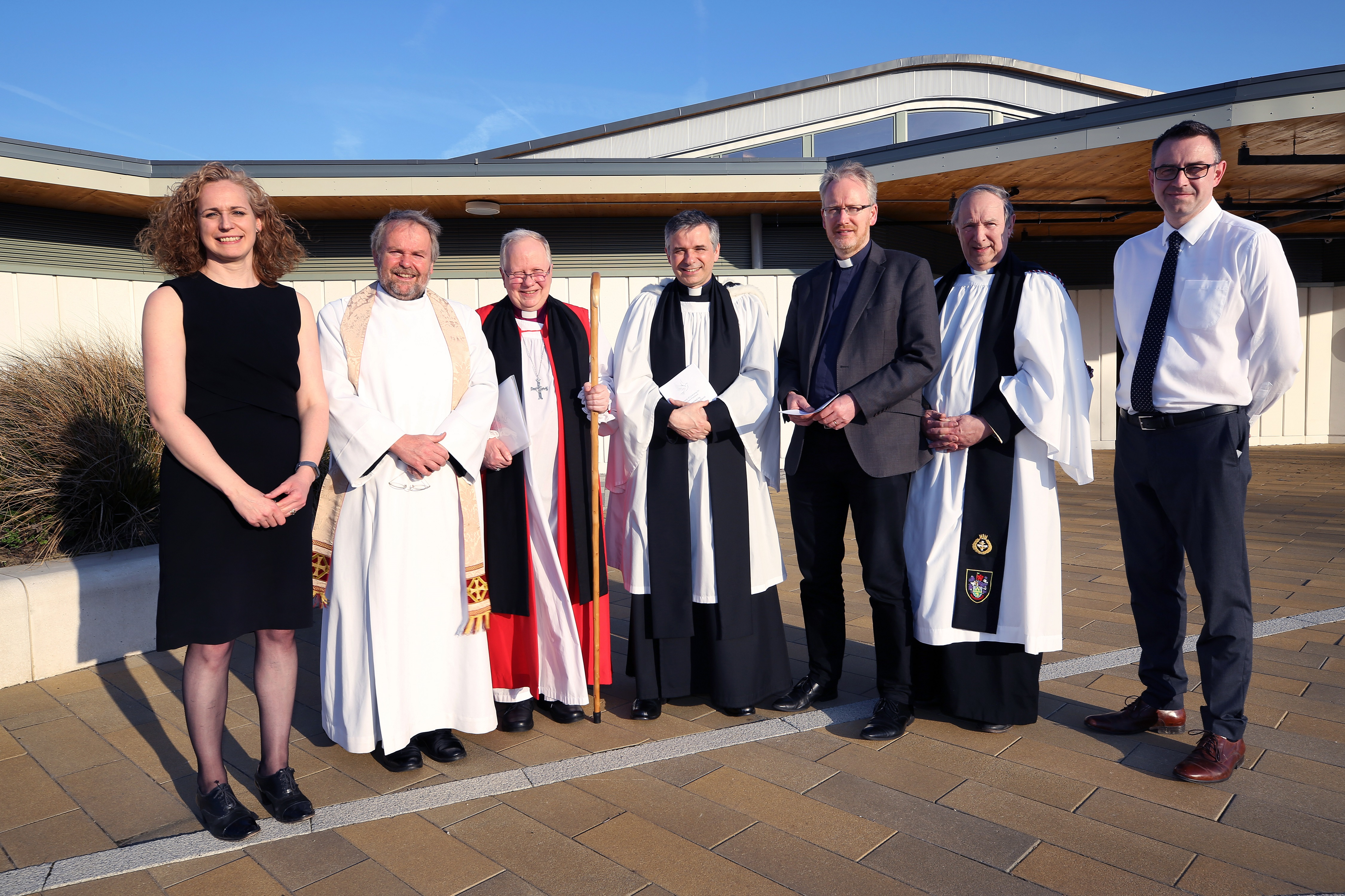 Reverend Rob Paddison outside the Ermine Street Church Academy, with left to right: Rebecca Britton, Urban&Civic, The Venerable Hugh McCurdy, Archdeacon of Huntingdon and Wisbech, Right Reverend David Thomson, Bishop of Huntingdon, Revd Rob Paddison, Pete (Click to enlarge)
