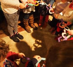 Sharing the heart paper chain prayer at the Christingle Celebration